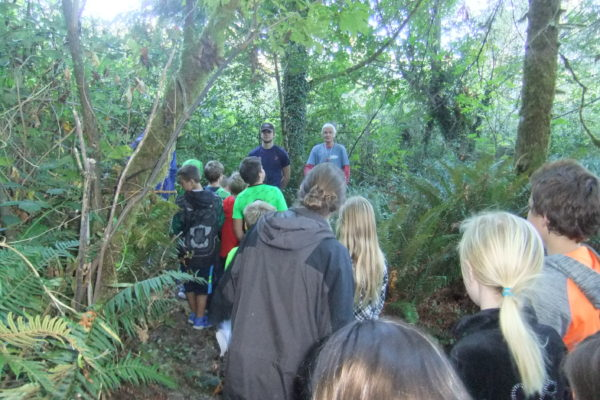 Gold Beach fourth graders are led on a hike, led by high school students and Jim.